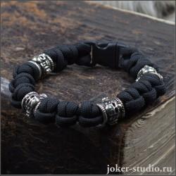 Купить браслет из чрного паракорда с черепами мужской стильный аксессуар