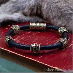 Браслет с черепом и бусами Сварога из бронзы на кожаном плетеном шнуре