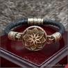 Женский браслет с бронзовой звездой Алатырь на кожаном плетеном шнуре