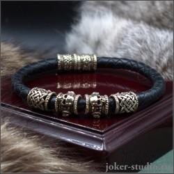 Браслет кожаный с плетением и черепами с символом Звезда Руси